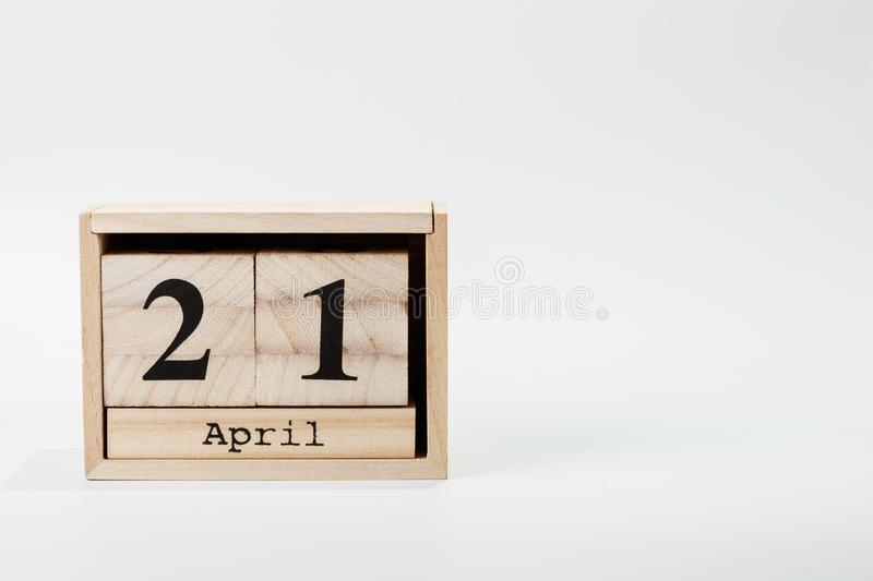 Wooden calendar April 21 on a white background. Close up royalty free stock photography