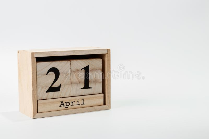 Wooden calendar April 21 on a white background. Close up stock photo