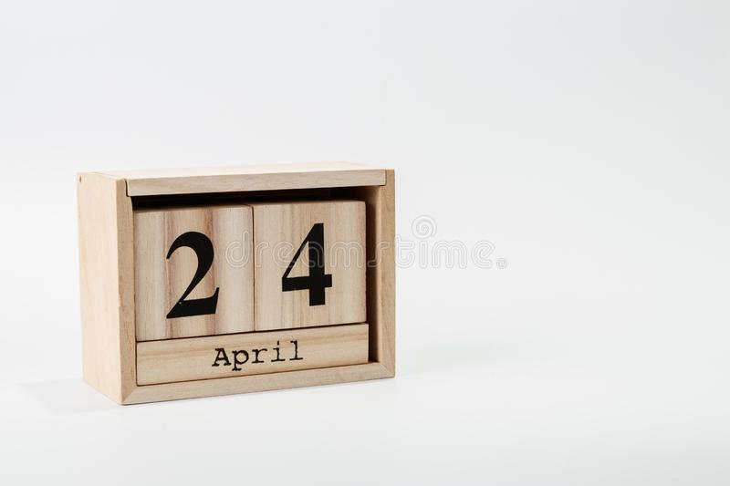 Wooden calendar April 24 on a white background. Close up royalty free stock photo