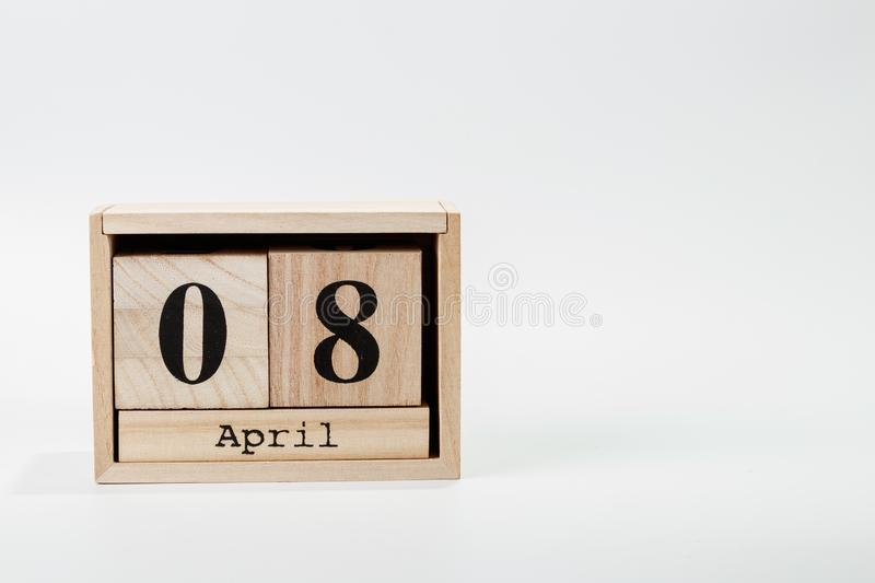 Wooden calendar April 08 on a white background. Close up royalty free stock photography