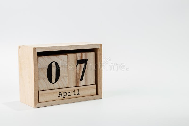 Wooden calendar April 07 on a white background. Close up stock photography