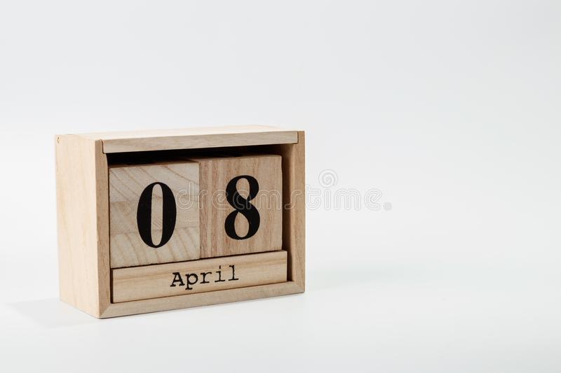 Wooden calendar April 08 on a white background. Close up stock photo