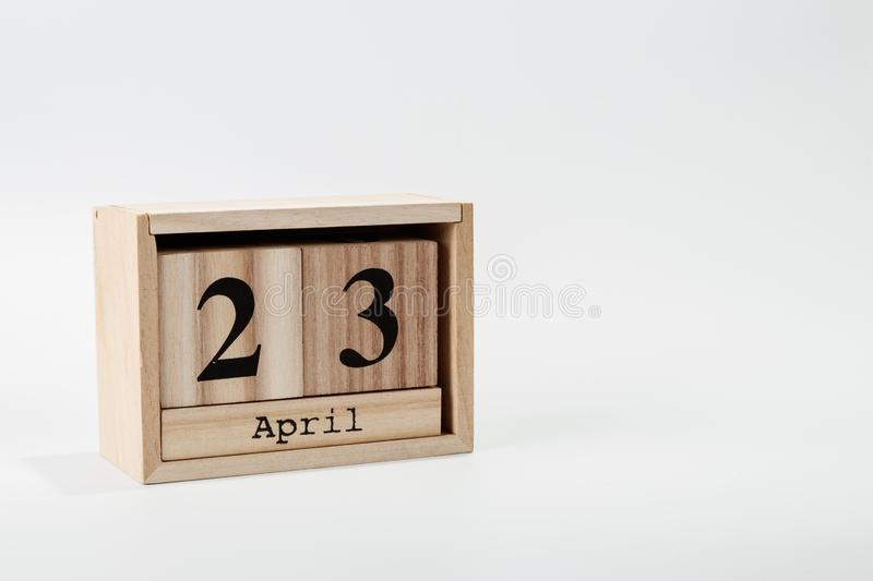Wooden calendar April 23 on a white background. Close up royalty free stock images