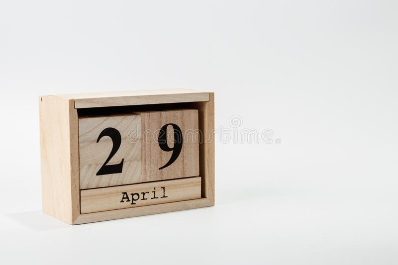 Wooden calendar April 29 on a white background. Close up stock image