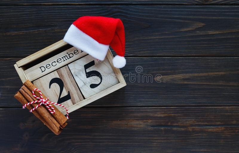 Wooden calendar on brown background.  New year and Christmas decoration, greeting card royalty free stock photography