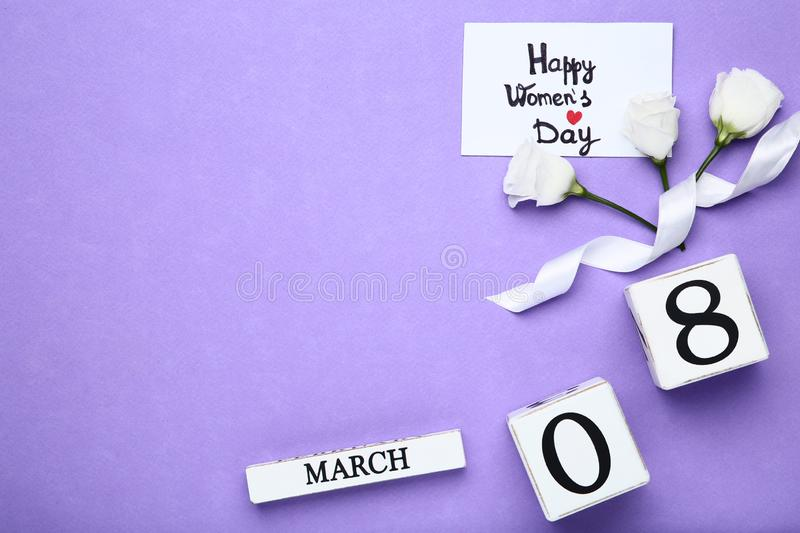 Wooden calendar with flowers. Wooden calendar with eustoma flowers and text Happy Women`s Day royalty free stock photo