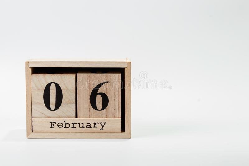 Wooden calendar February 06 on a white background. Close up stock image