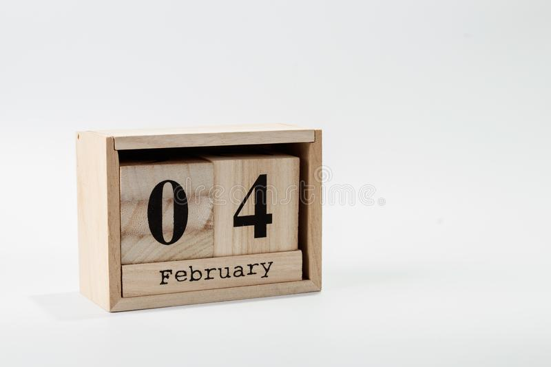 Wooden calendar February 04 on a white background. Close up royalty free stock images