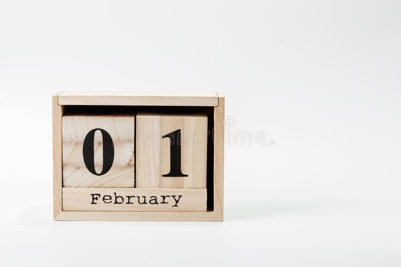 Wooden calendar February 01 on a white background. Close up stock photo