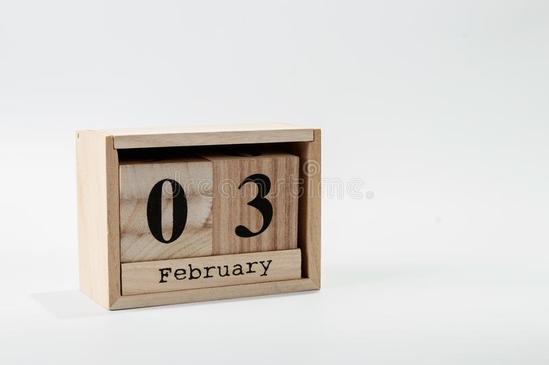 Wooden calendar February 03 on a white background. Close up royalty free stock images
