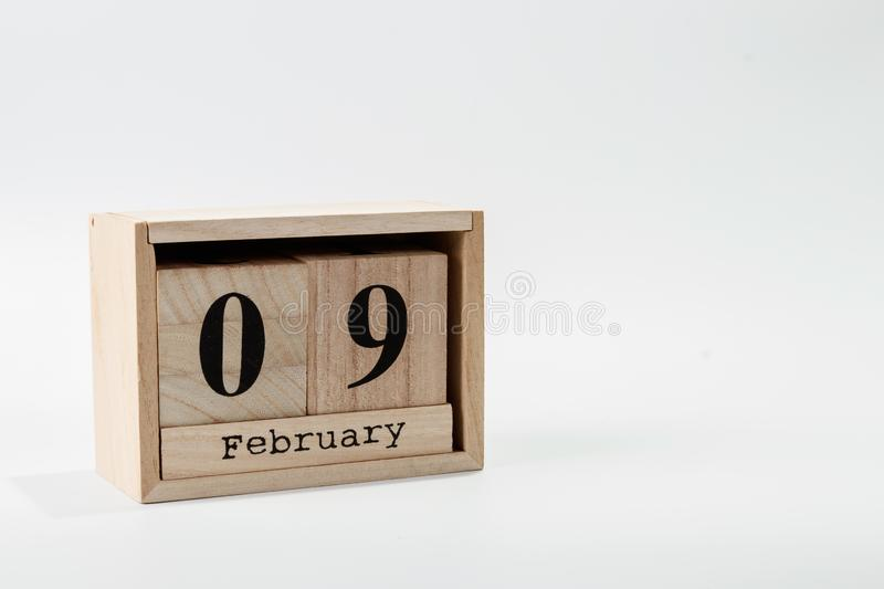 Wooden calendar February 09 on a white background. Close up royalty free stock image