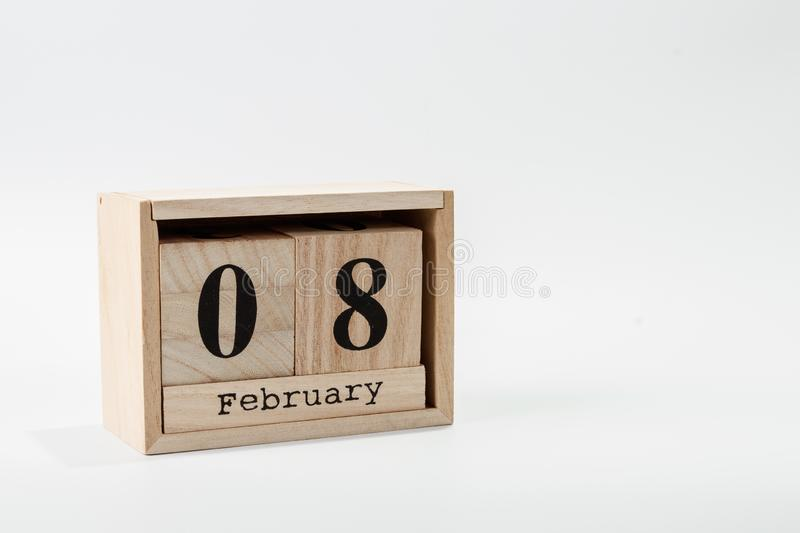 Wooden calendar February 08 on a white background. Close up stock photo