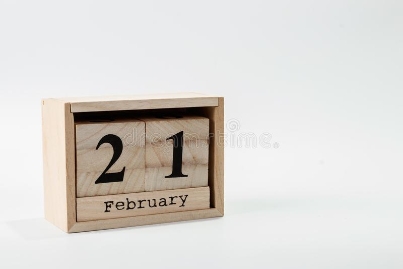 Wooden calendar February 21 on a white background. Close up royalty free stock photography