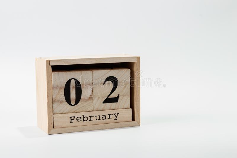 Wooden calendar February 02 on a white background. Close up royalty free stock image