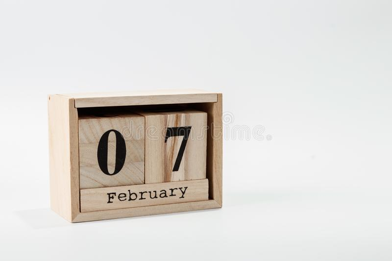 Wooden calendar February 07 on a white background. Close up royalty free stock photography