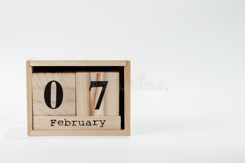 Wooden calendar February 07 on a white background. Close up royalty free stock photos