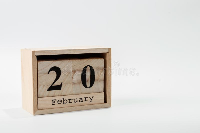Wooden calendar February 20 on a white background. Close up stock images
