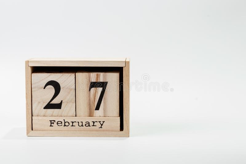 Wooden calendar February 27 on a white background. Close up royalty free stock images