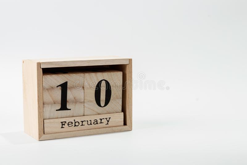 Wooden calendar February 10 on a white background. Close up royalty free stock image