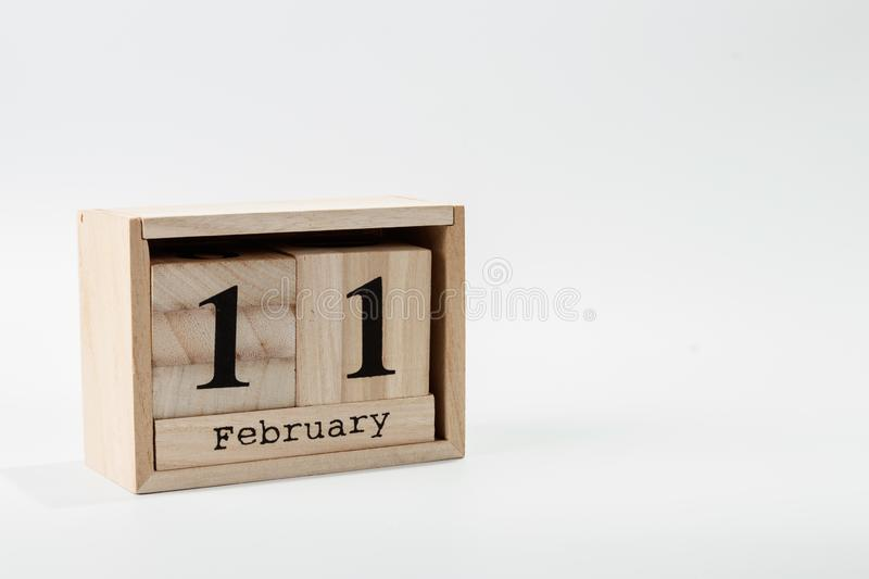 Wooden calendar February 11 on a white background. Close up royalty free stock images