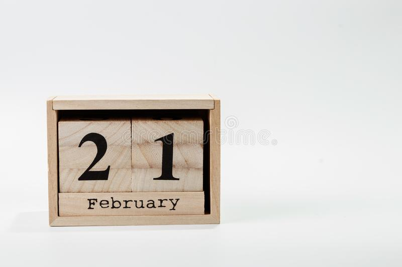 Wooden calendar February 21 on a white background. Close up stock photography
