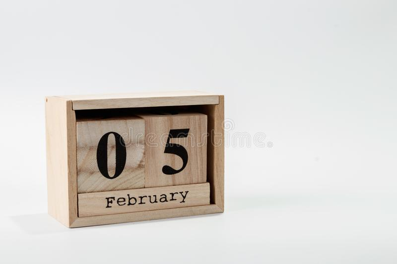 Wooden calendar February 05 on a white background. Close up stock photography