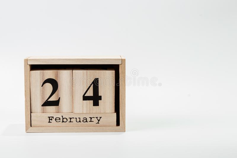 Wooden calendar February 24 on a white background. Close up stock image