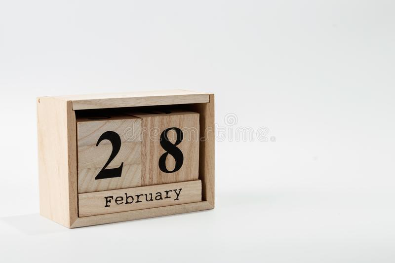Wooden calendar February 28 on a white background. Close up royalty free stock photos