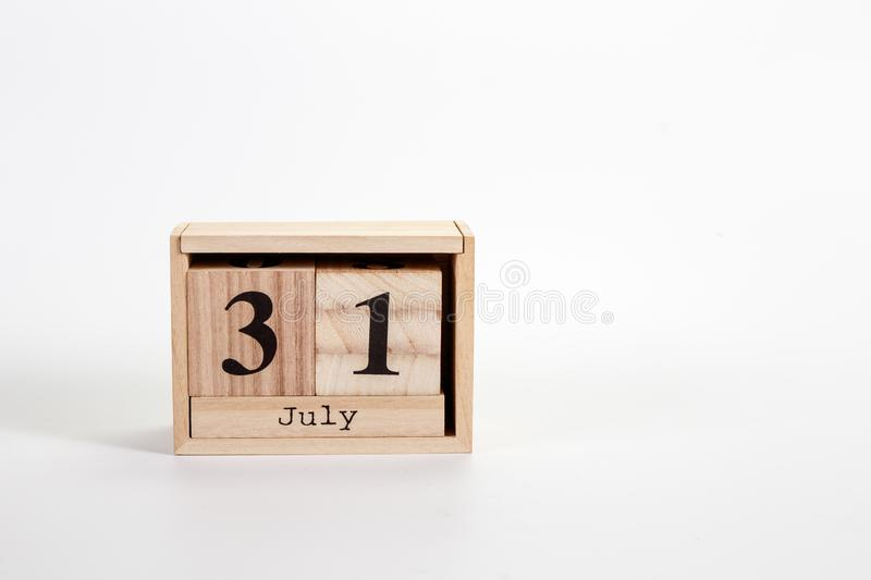Wooden calendar July 31 on a white background. Wooden calendar Julye 31 on a white background close up royalty free stock photos