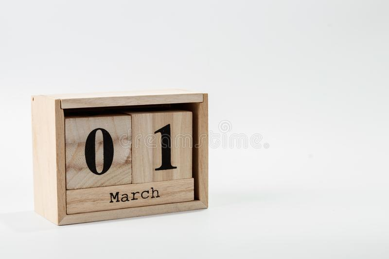 Wooden calendar March 01 on a white background. Close up stock photo