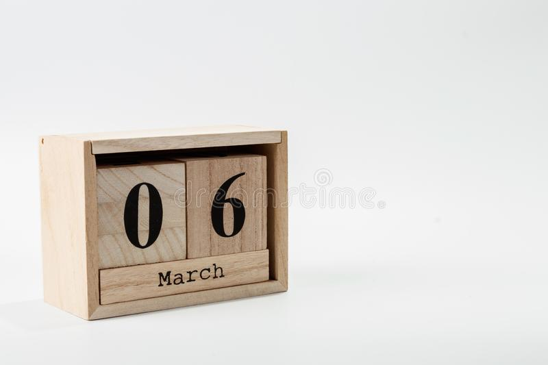 Wooden calendar March 06 on a white background. Close up royalty free stock image