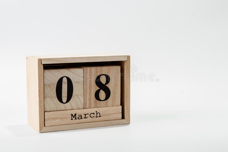 Wooden calendar March 08 on a white background. Close up royalty free stock images