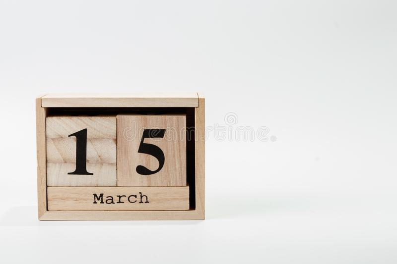 Wooden calendar March 15 on a white background. Close up royalty free stock photography