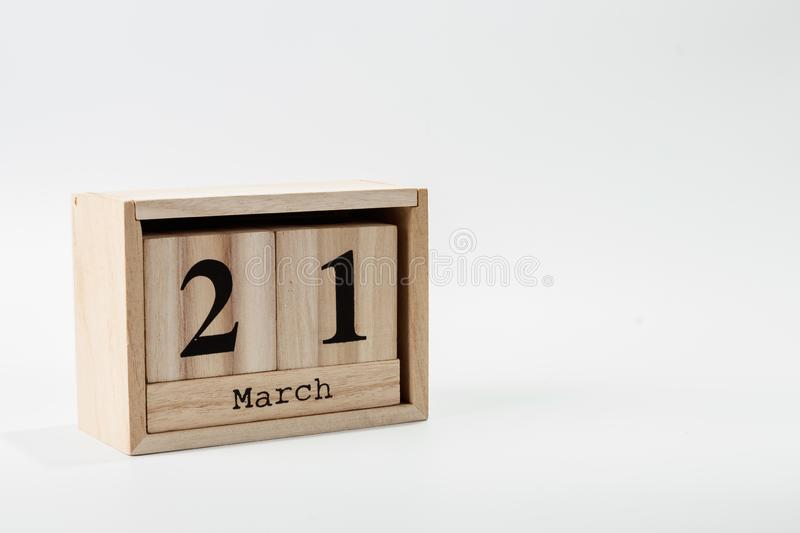 Wooden calendar March 21 on a white background. Close up stock photos