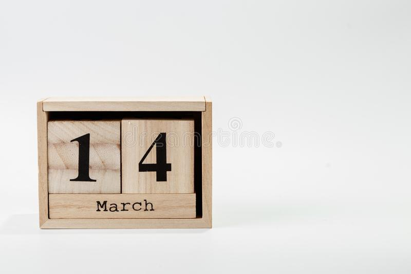 Wooden calendar March 14 on a white background. Close up stock images