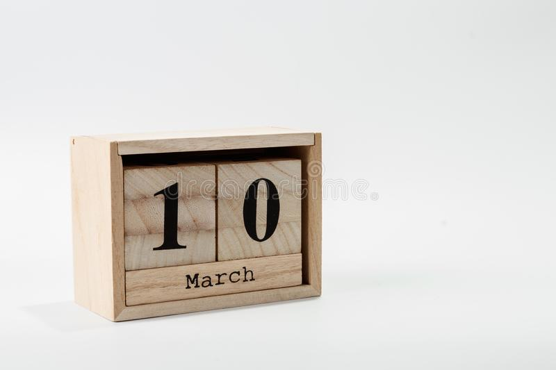 Wooden calendar March 10 on a white background. Close up royalty free stock photos