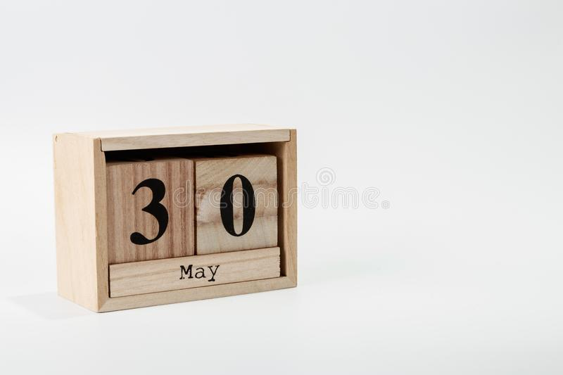 Wooden calendar May 30 on a white background. Close up stock photo