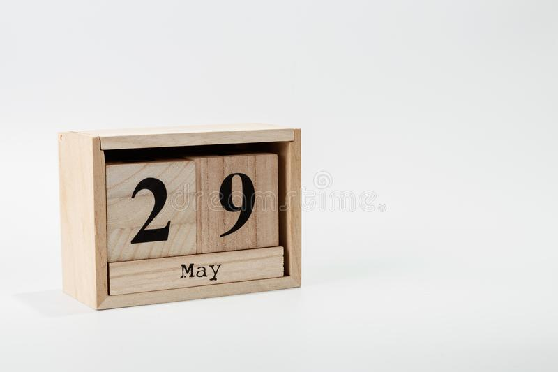 Wooden calendar May 29 on a white background. Close up stock image
