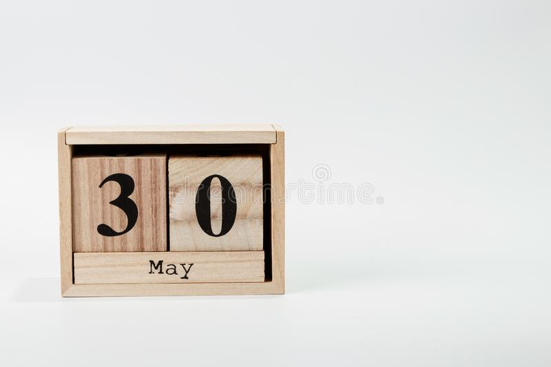 Wooden calendar May 30 on a white background. Close up stock photos