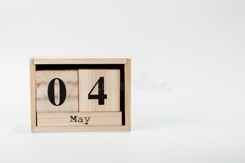 Wooden calendar May 04 on a white background. Close up stock image