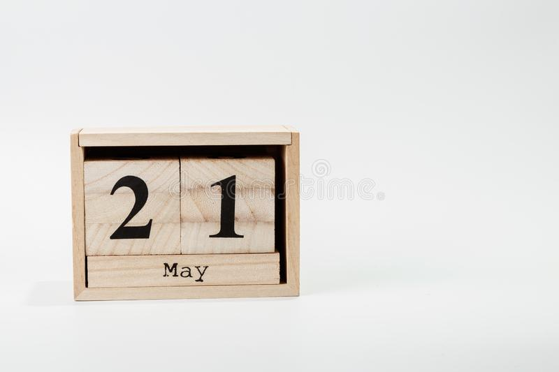 Wooden calendar May 21 on a white background. Close up stock photo