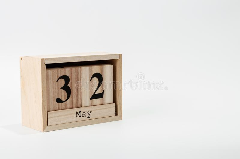 Wooden calendar May 32 on a white background. Close up royalty free stock photos