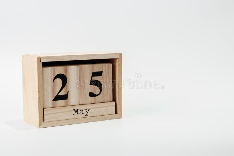 Wooden calendar May 25 on a white background. Close up stock photos