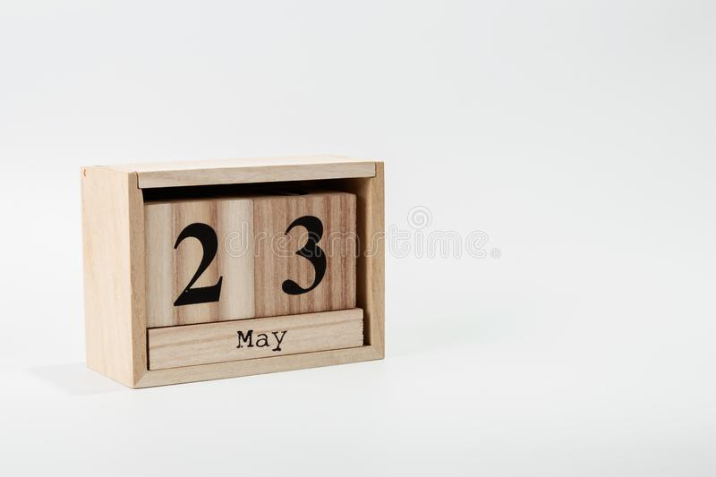 Wooden calendar May 23 on a white background. Close up royalty free stock photo