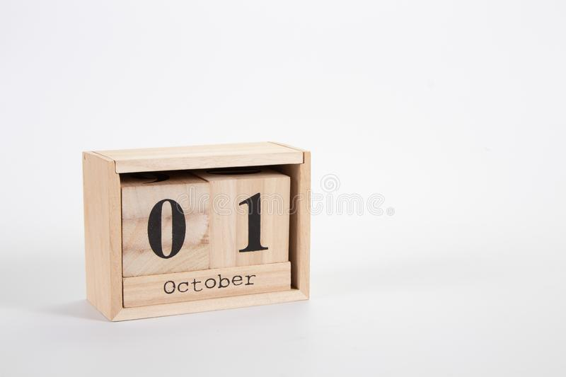 Wooden calendar October 01 on a white background. Close up royalty free stock images