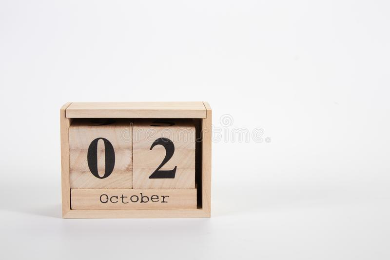 Wooden calendar October 02 on a white background. Close up stock photo