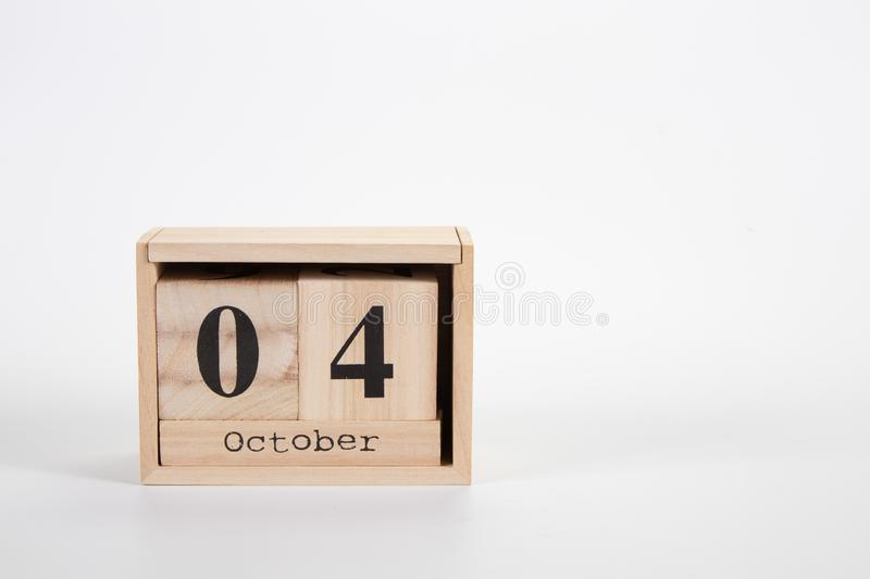 Wooden calendar October 04 on a white background. Close up stock image