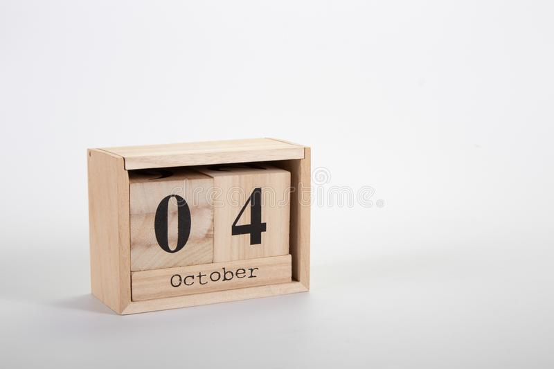 Wooden calendar October 04 on a white background. Close up royalty free stock photos