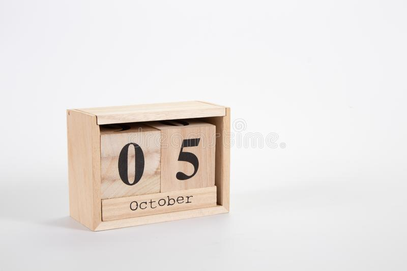 Wooden calendar October 05 on a white background. Close up stock photo