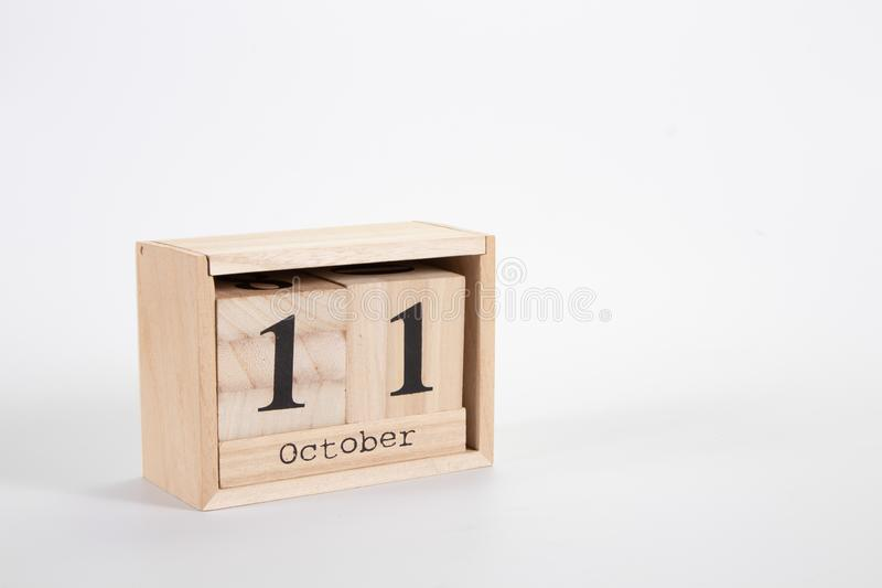 Wooden calendar October 11 on a white background. Close up royalty free stock images